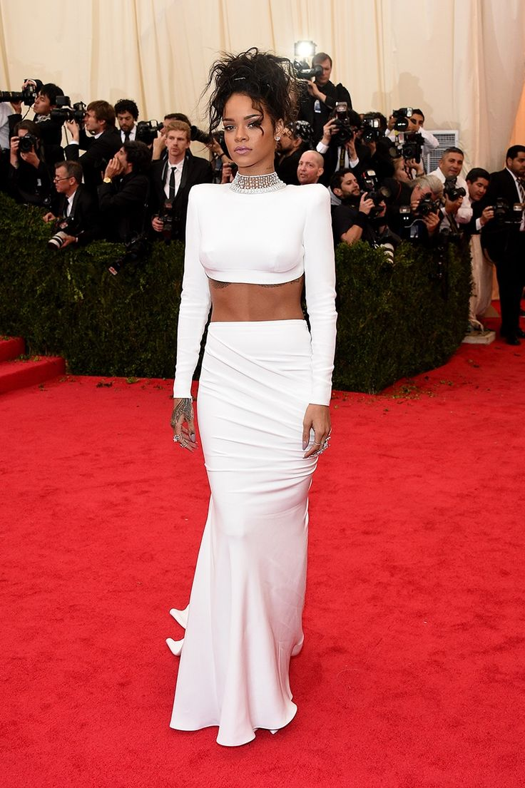 Rihanna in a Stella McCartney dress, Jacob & Co necklace, Cartier rings, and Dionea Orcini rings at the Met Gala 2014. See more on Vogue.com.