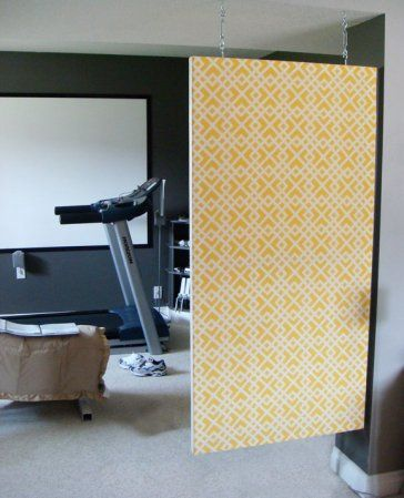 DIY: Room Divider for unfinished basement space.  So easy and perfect because I'm having trouble with the permanency of building actual walls in the basement.  I keep thinking what if I build a wall there and decide I don't like it.  I like the open space, but some compartmentalizing would be nice.