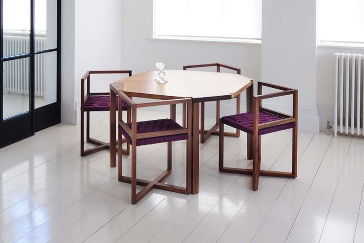 Woven Angled Seating Fits Snugly Into Notched Out Sections On This Table