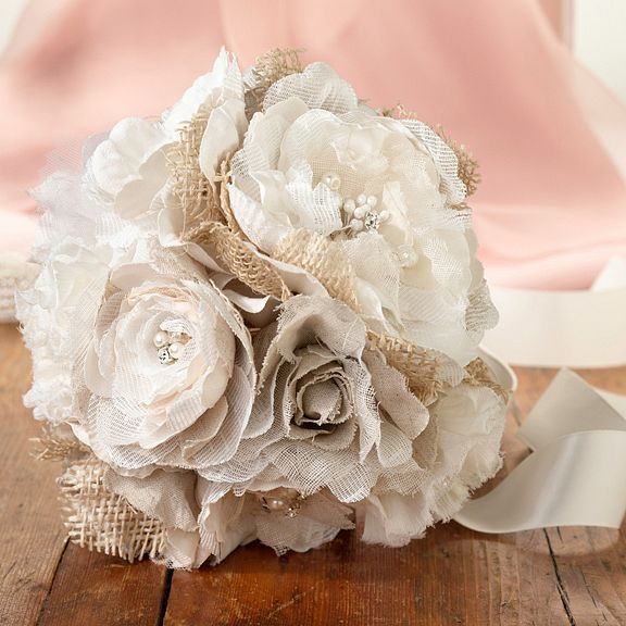 These burlap and flower bridal bouquets are a charming and easy way to add rustic romance to your wedding ceremony and make the perfect bridesmaids bouquets. See it here: http://myweddingreceptionideas.com/burlap-flower-bridal-bouquet.asp