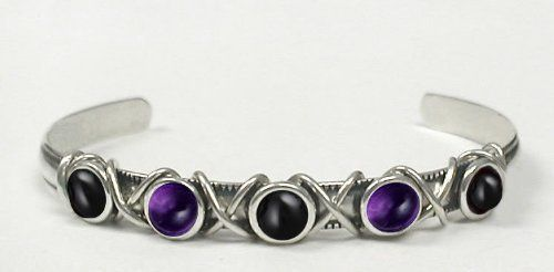 A Beautiful Sterling Silver 5 Stone Hand Made Cuff with Genuine Black Onyx Accented with Amethyst and Black Onyx The Silver Dragon- Bracelets. $68.00. The Silver Dragon uses Sterling Silver that has been Reclaimed... Helping Save Mother Earth's Resources.. This Bracelet Fits a Standard Woman's Wrist. When You Buy From The Silver Dragon, You Are Helping to Employ American Workers. Please Support American Business.. Designed And Hand- Crafted By A Silver Artisan Here in Ame...
