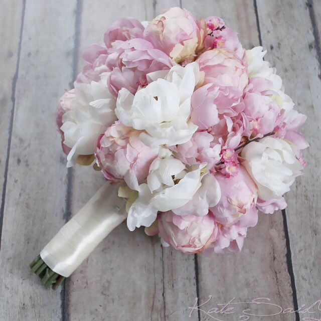 I love the addition of ivory peonies to this cherry blossom wedding bouquet! By Kate Said Yes Weddings.