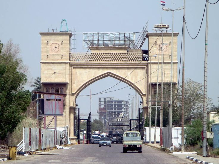 Access to Saddam Hussein's former palace complex in Basra, Iraq, is through this ramshackle gateway.