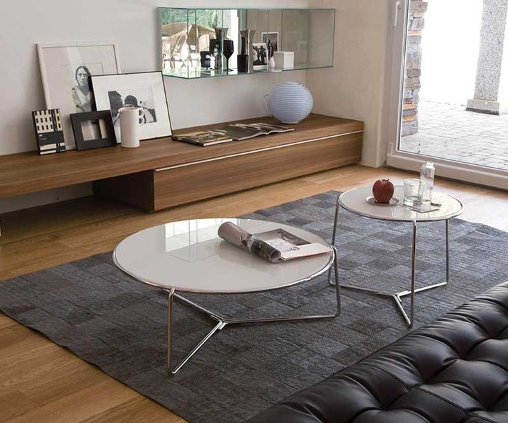Our range of Fil coffee tables have removable glass tops and come in many colours. They can be stand alone or clustered together.  See for yourself here.