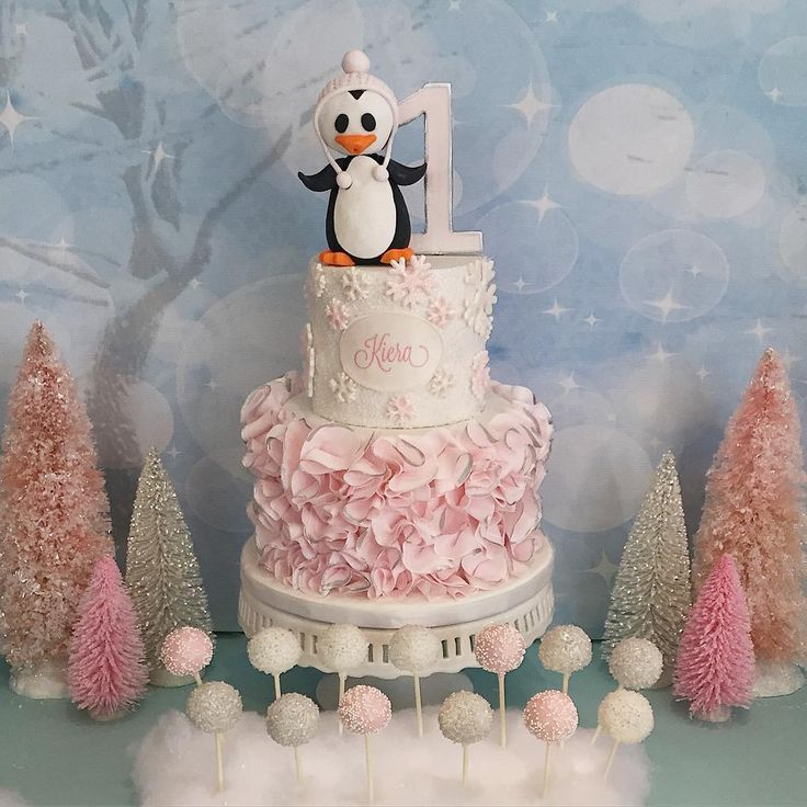 winter wonderland onederland birthday baby shower cake pink ruffles penguin silver and pink rooneygirl bakeshop