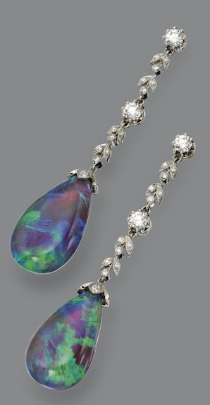 PAIR OF BLACK OPAL AND DIAMOND EARRINGS The pear-shaped black opal drops supported on long fringes of foliate motif, set with 52 round diamonds weighing approximately 1.25 carats, mounted in platinum.