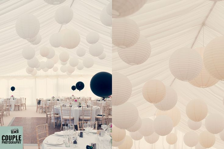 Marquee decoration. Classic understated decoration. Baloons, white lanterns. Irish Marquee wedding photographed by Couple Photography.
