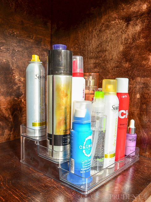 Great idea! Organize hair products under the sink on a tiered organizer. (Said it was an acrylic tiered spice rack from walm) - L