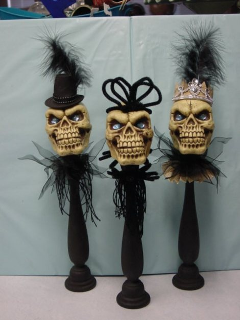 **(FS) Just Dollar store plastic skulls dressed up a little and stuck on a candle stick!  LOVE IT!