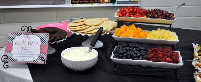 Mini fruit pizza bar - They used sugar cookies and brownie cookies as the crust with  fruit for the toppings.  Great idea for a 30th, 40th, 50th, or any birthday party dessert.