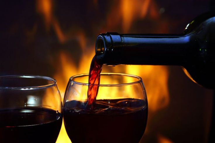 Relaxing with a glass of wine at the fireplace