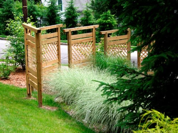 Instead of putting up an entire fence, build a privacy barrier with wood panels. Learn how on HGTV.com.
