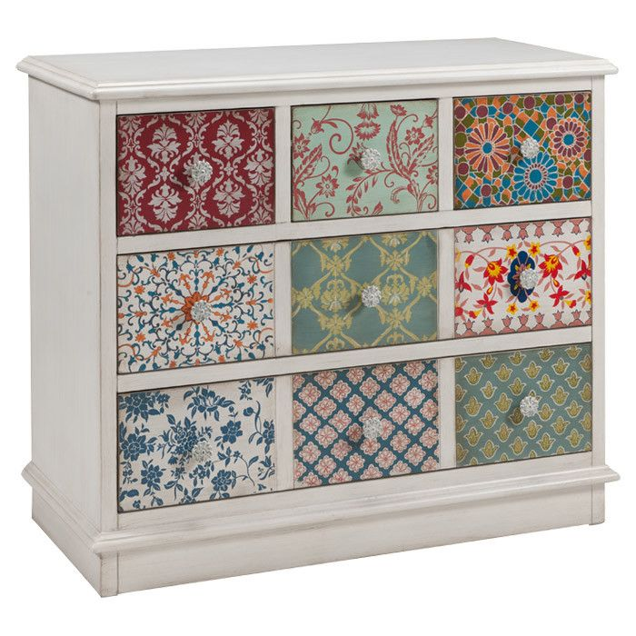 Multi-pattern drawer fronts give this charming chest an eclectic, folk art feel, making it perfect for country retreats and boho lofts alike.