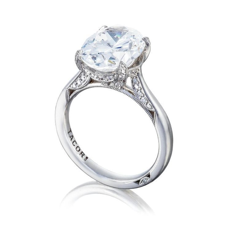 All eyes will be on your center diamond, in this not so simple solitaire  oval cut diamond engagement ring. A sleek band with secret diamond details  along ...