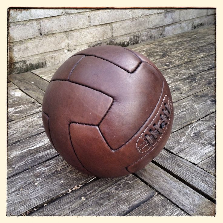 Old style brown leather soccer ball