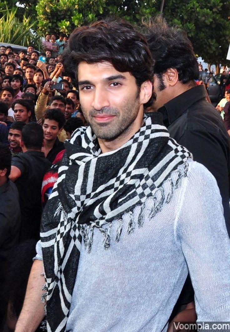 Aditya Roy Kapur looks too cute in a grey sweater and a scraf. via Voompla.com