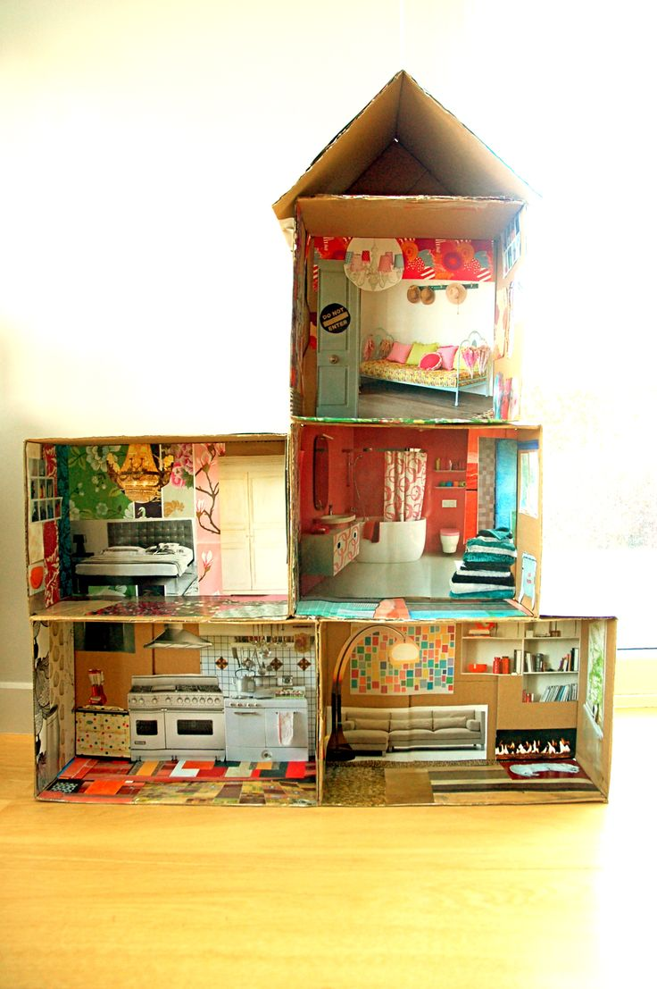 Really cool idea - cardboard doll house with magazine pictures. Could do with a firehouse/something more boyish, too.