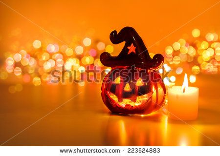 Halloween pumpkin with candlelight and bokeh background
