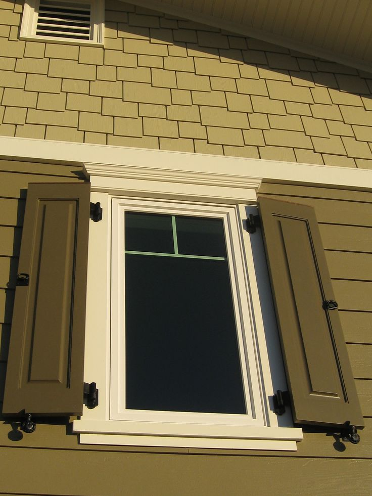 Raised panel exterior shutters with functional shutter hardware great shingles above for Hardware for exterior shutters