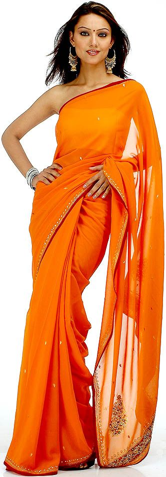 Resultados da pesquisa de http://www.exoticindia.com/saris/burnt_orange_sari_with_beads_and_mirrors_yc64.jpg no Google