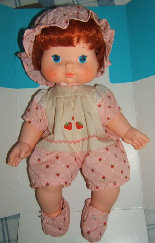 "Strawberry Shortcake blow kiss baby dolls- One of my earliest toys. You could squeeze her and she would ""breathe"" out a strawberry scent."