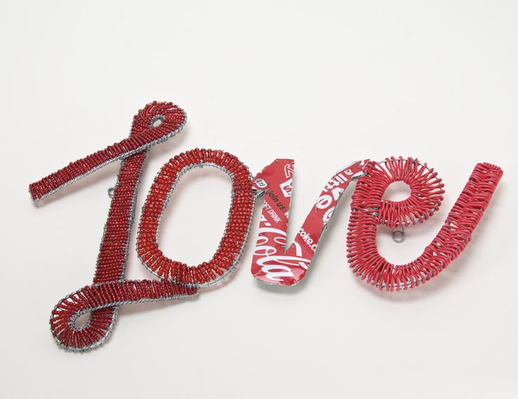 Love sign made from wire, beads, Coke cans and telephone wire ProjectZA.com
