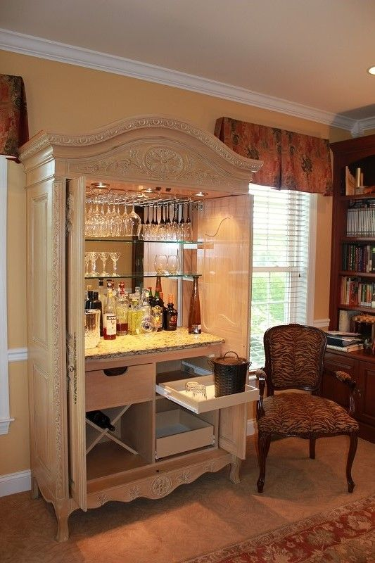 This armoire started as your typical entertainment center.  With the change to flat screen in televisions, it has out lived its usefulness. But my customer couldn't bear to part with it.  Look at it now!!!  It has found a new purpose, we have converted it to a beautiful bar with all the amenities one needs for a fabulous cocktail party.   ...Repurpose-Refinish-Restore... www.vintage-repurposed.com