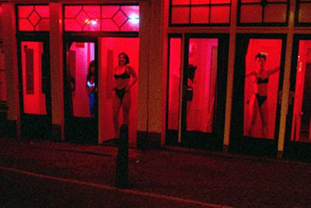 """The red light district is one of the most famous """"sightseeing"""" places in the Netherlands. Here you can hire a girl for your own sexual needs. This street is in Amterdam.  There are not many other places on the world, where you can see the ladies, just behind the window. They are standing in the shopwindow, which is pretty rare. This is not really a personal symbol of me, but it is a symbol of The Netherlands.  (Kevin Ewalds)"""