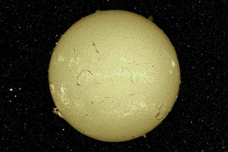 [Yellow] sun in front of starfield