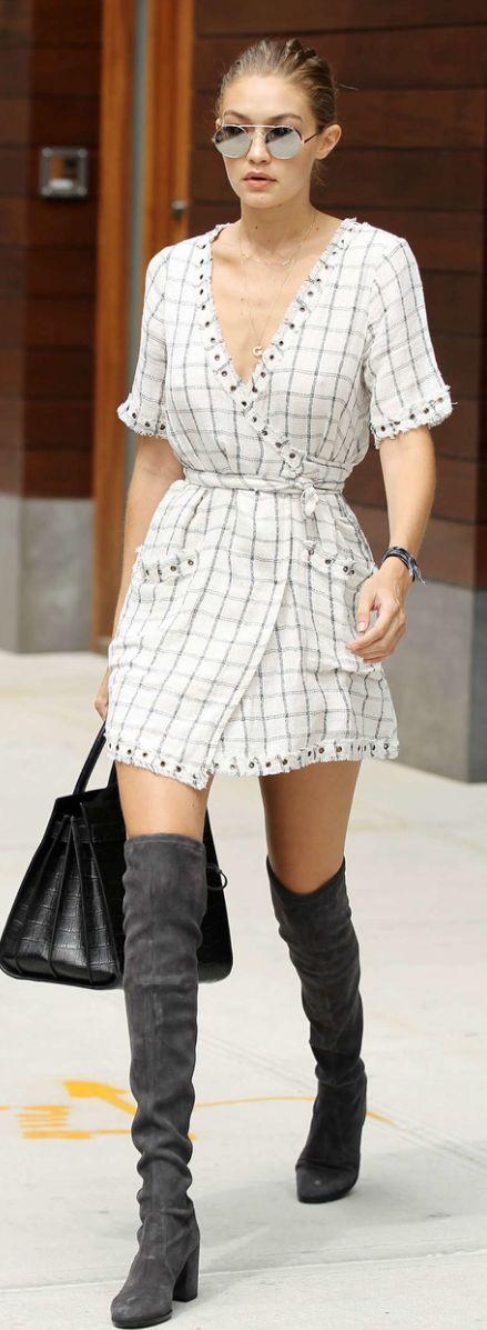 Who made  Gigi Hadid's silver round sunglasses, white plaid wrap dress, gray suede thigh boots, and black tote handbag?