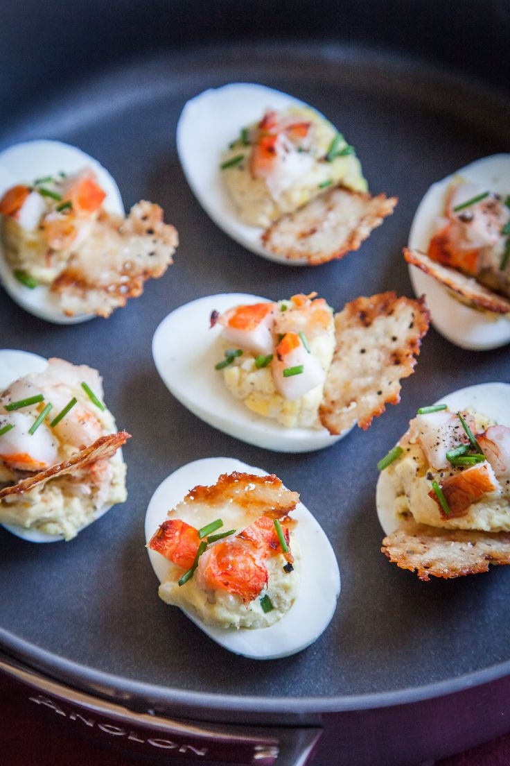 Lobster and Chives Deviled Eggs with Truffle Salt and Parmesan Crisp – Not all deviled eggs are made the same way. These luxurious version of the standard appetizer uses lobster meat and truffle salt to elevate the classic dish. The addition of the Parmesan crisp may seem like gilding the lily but they are so easy to make that you might as well go all out and make them for a stunning presentation and nibbly bite.