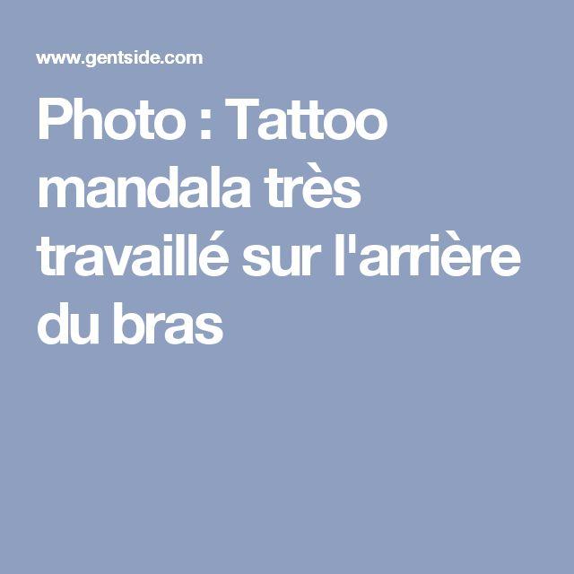 Photo : Tattoo mandala très travaillé sur l'arrière du bras