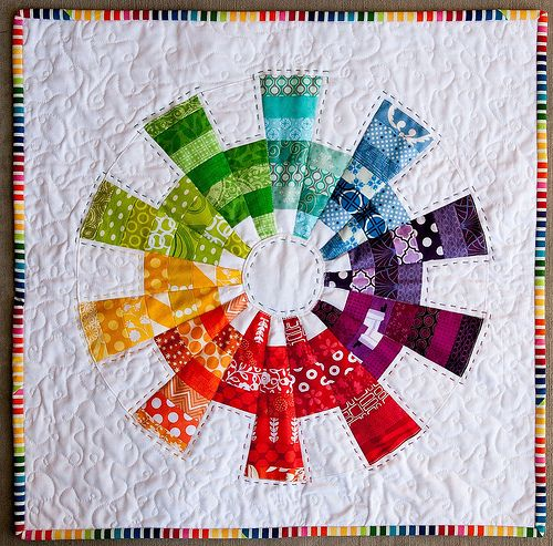 Easy Dresden Quilting Tutorial - Color Cog Mini Quilt   this is one dresden I can see doing.  I can't do all those busy farics like flowers but this is cool