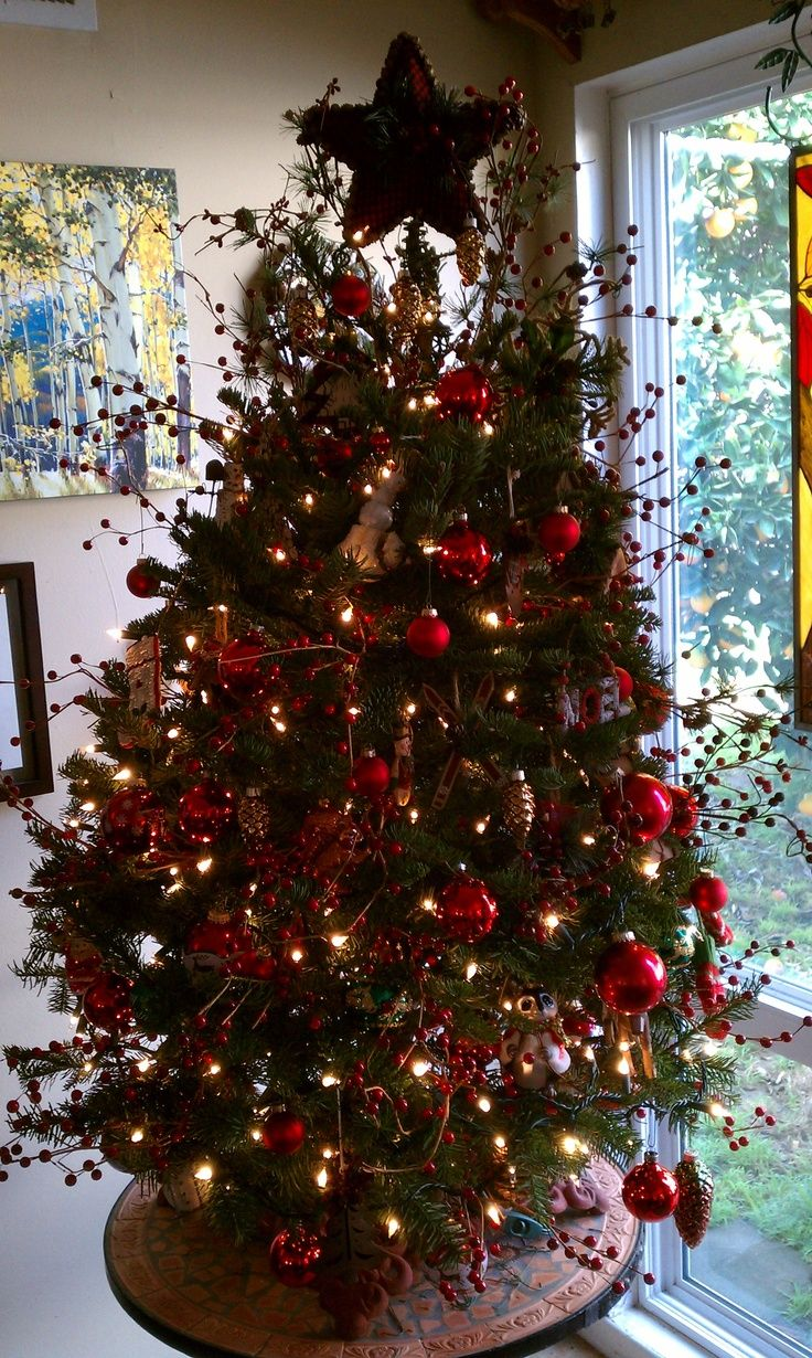 rustic Christmas tree with berry sprigs  Woodsy Christmas