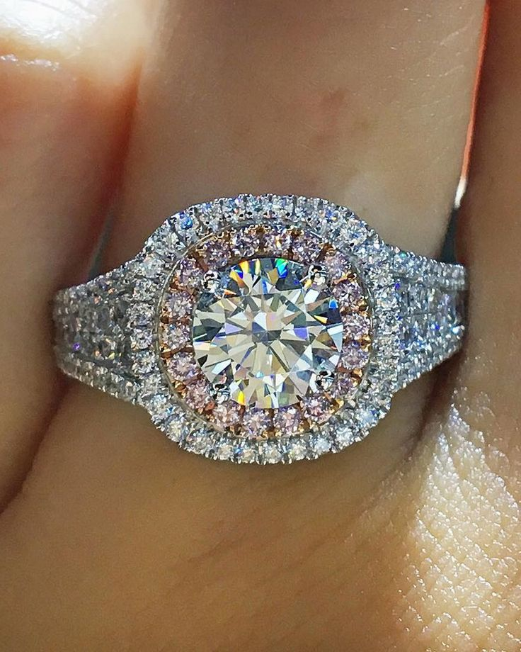 """White gold with a delicate touch of rose gold.  Would you say """"yes""""?  #diamondring #diamonds #engagementrings #trophywife"""