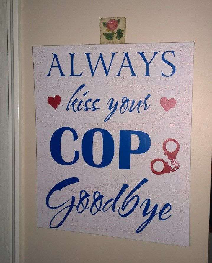"Our new wall hanging. ""Always Kiss your COP Goodbye"""