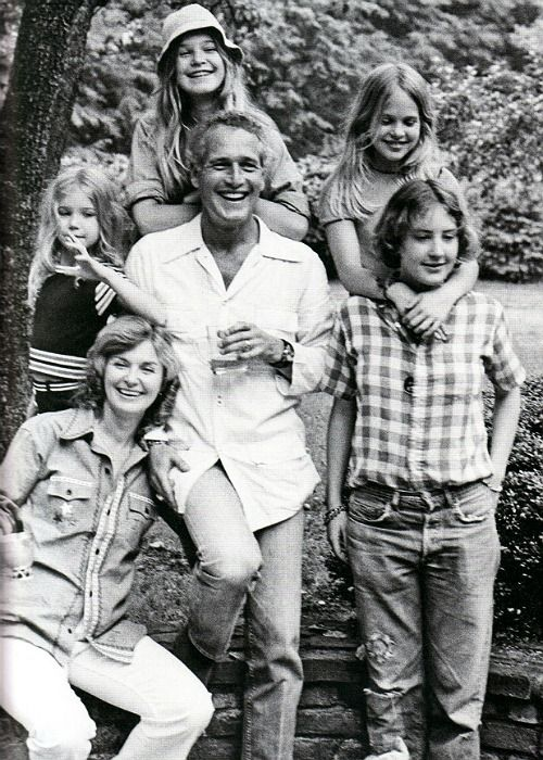 A real family man in Hollywood.    Paul Newman at home in '73 with (clockwise from center left) Clea, Nell, Melissa, Stephanie and Joanne.