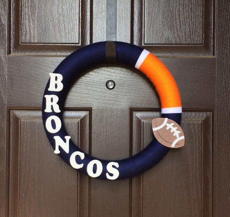 Broncos Yarn Wreath, Broncos Wreath, Denver Broncos Wreath, Brandies Broncos Wreath, Orange and Blue Wreath, Boise State by CarisasCollections on Etsy https://www.etsy.com/listing/240956239/broncos-yarn-wreath-broncos-wreath