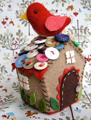 Betz White's Bird House.  Love the bright red bird, and the chocolate-biscuit-like house with random buttons on the roof.