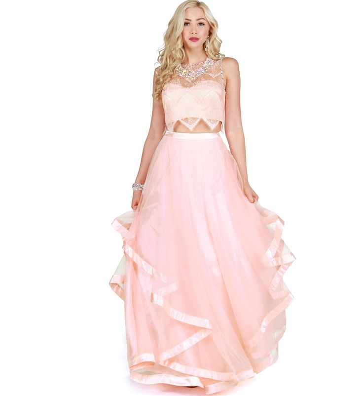 FREE SMARTPOST SHIPPING ON ALL SIERRA DRESSES. As Seen In Seventeen Prom.Sierra Furtado x WindsorA dress so perfect it's fit for royalty! This two piece ensemble features a sleeveless lace crop top with a round neckline, semi exposed back and beautiful gem stone trim detail. The breathtaking skirt features full tiered tulle fabric with a satin trim. Both top and bottom include a back zipper.By Alex and SophiaSpecial OccasionTwo PieceLined Bust100% PolyesterProfessional spot clean…