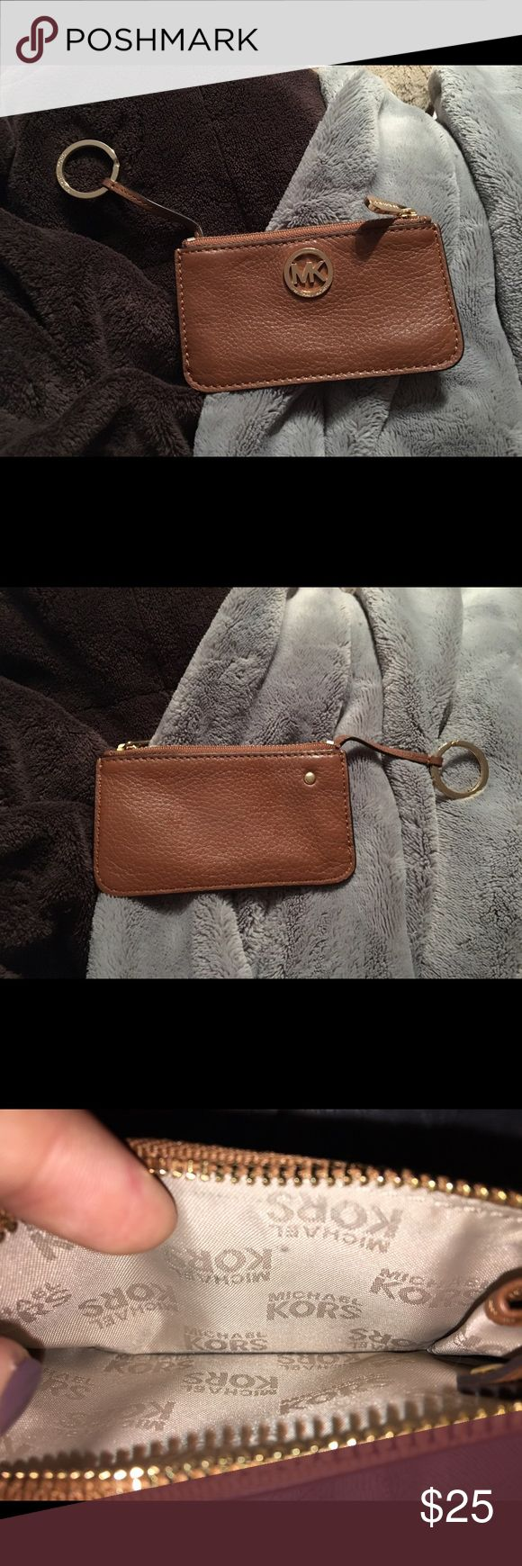 Authentic Michael Kors keychain/coin purse Bought the Michael Kors store. Barely used. Michael Kors Bags Wallets