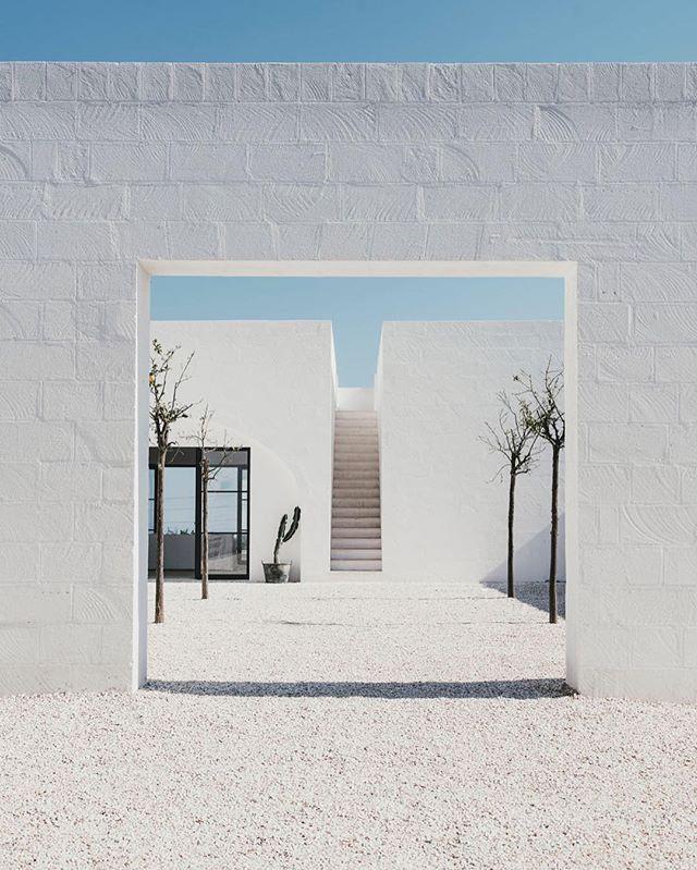 Love entering through the front gate. design by @andrewopenhouse photo @salvalopez #masseriamoroseta #ostuni #puglia #architecture