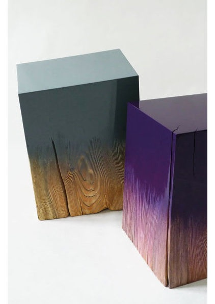 Dip-dyed effects are most striking when combining a bright color and a natural material — such as these raw wood blocks.