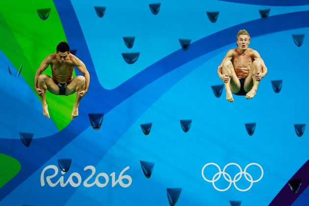 Jack Laugher and Chris Mears of Great Britain compete in the Men's Diving Synchronised 3m Springboard Final on Day 5.  | Best Photos From The Rio Olympics