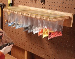 Cut slots in a piece of plywood with a jigsaw. Fill resealable bags with small parts, hardware or craft items and hang them from the slotted plywood.