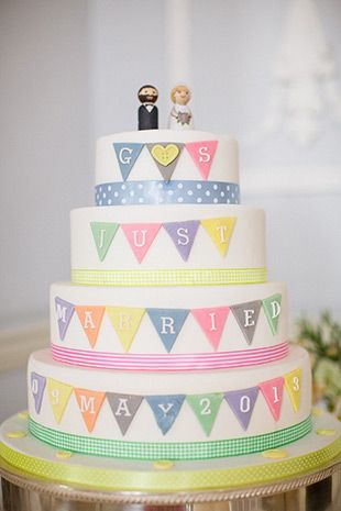 pastel bunting wedding cake with cute wooden cake toppers | onefabday.com