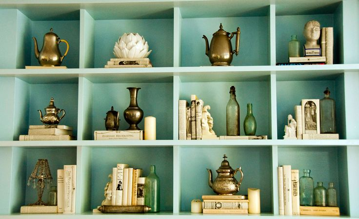 How to style shelves... Going to need this when the paint finally cures on our built ins! Love the triangle tip.