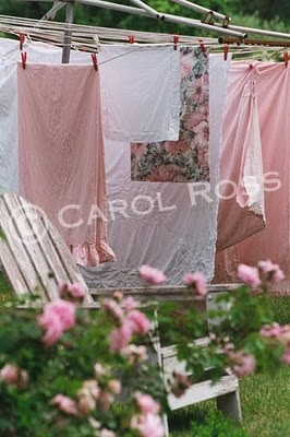 TIP: IF YOU HAVE A ROUND CLOTHES LINE LIKE THIS ONE AND YOU WANT IT PORTABLE ...USE YOUR OUTDOOR PATIO TABLE AND UMBRELLA STAND, SIMPLY PLACE IN THE HOLE OF THE TABLE AS YOU WOULD THE UMBRELLA  AND INTO THE STAND.
