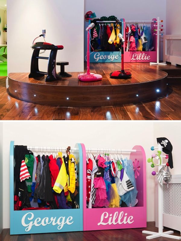 Children have their own stage in this fab playroom!!  (stage for the kids? are you kidding? i would ROCK that thing!)