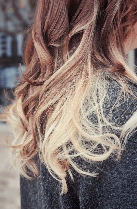 Ombre hair. So doing this at my next hair appt, but with different colors... blue/black on top... violet purple on the bottom :)